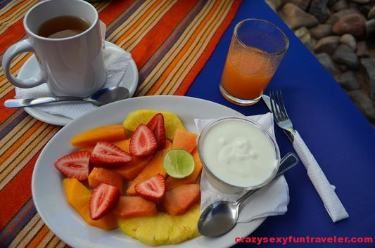fruit plate, tea and fresh papaya juice for breakfast