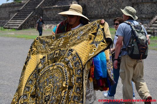 selling pareos with Aztec calendar in Teotihuacan Mexico