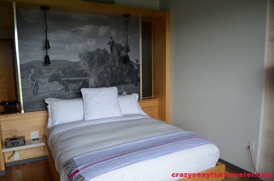 a bed in La Bergerie Hotel La Ferme