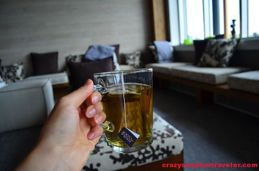 drinking herbal tea in Spa du Verger at Hotel La Ferme
