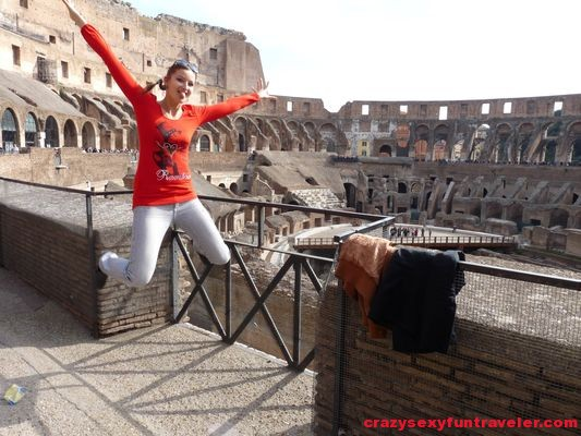 jumping around in Colosseum in Rome
