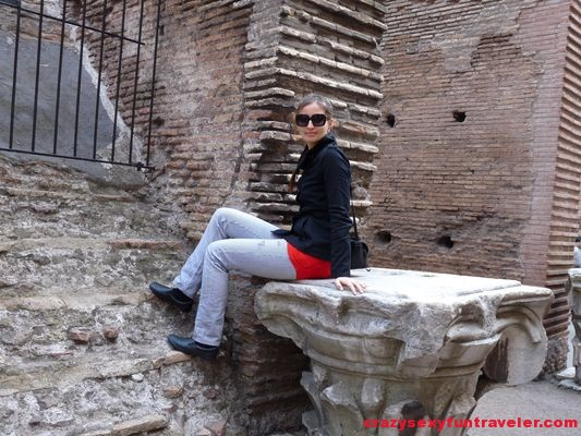 sitting on a staircase in Colosseum in Rome