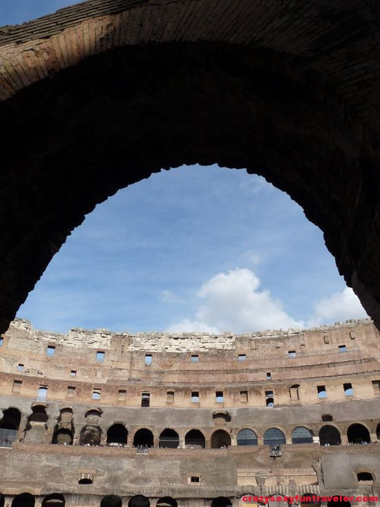 through an arch in Colosseum in Rome