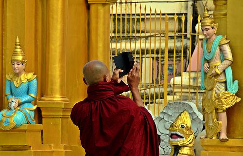a monk taking a photo