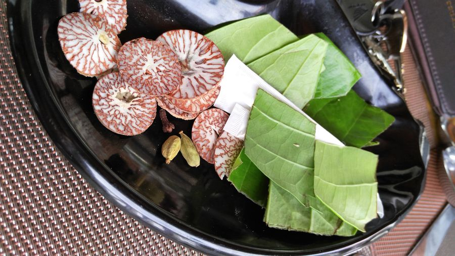 Maldives chewing areca nut with betel leaves and spices