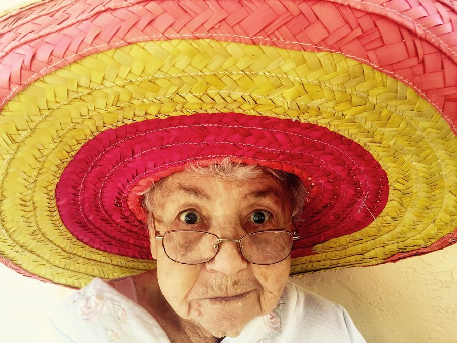 a Mexican lady in a traditional hat