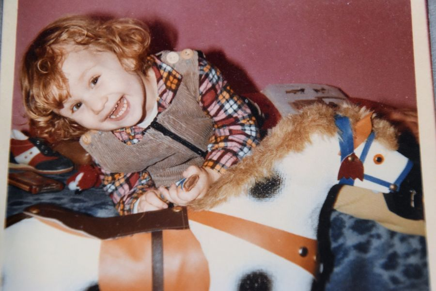 me as a baby gil with curly ginger hair