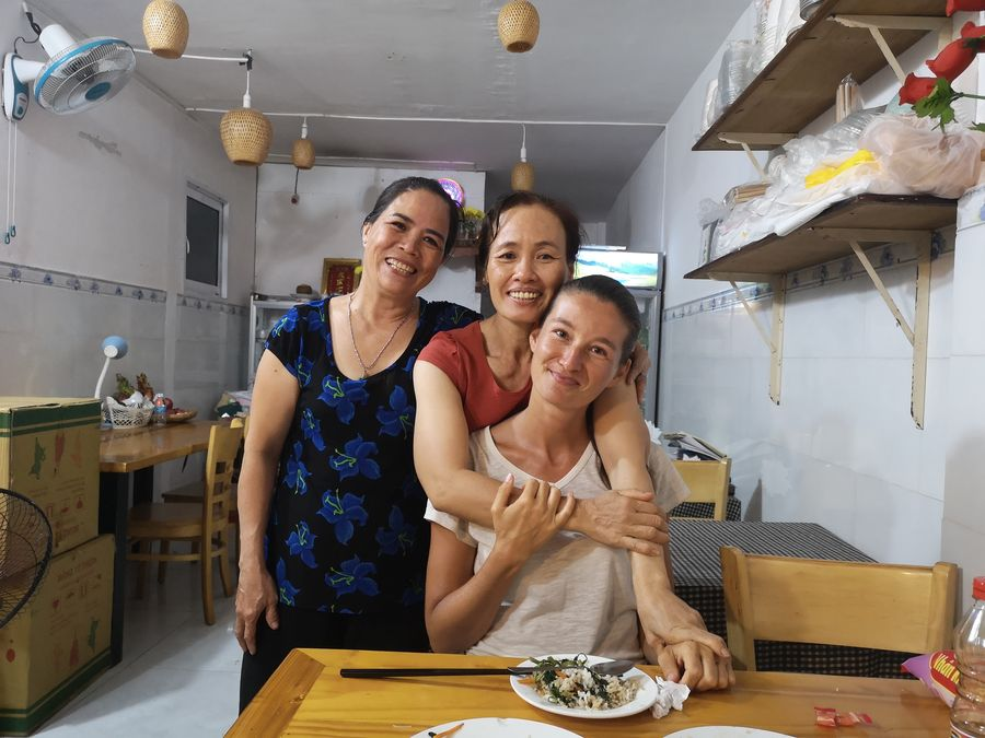 with the cook at Vegan restaurant Quan Chay Con Dao Healthy
