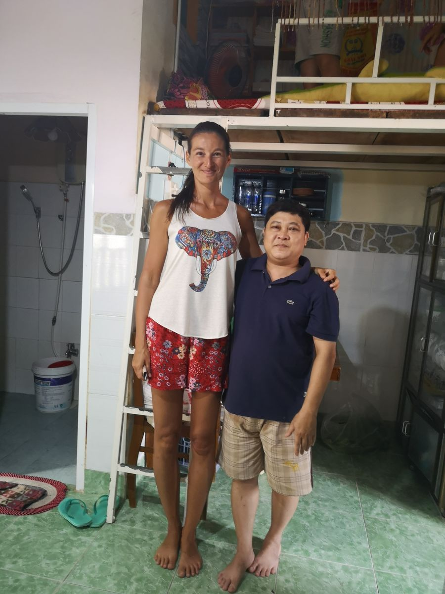 with the owner of the house where I stayed on Con Dao