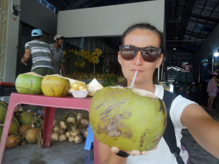 drinking a young coconut