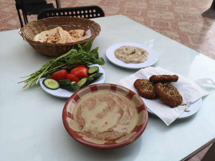 enjoying traditional Egyptian food alone