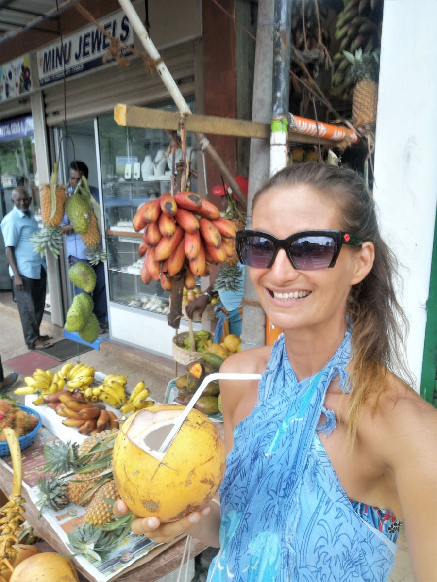 drinking young coconut water